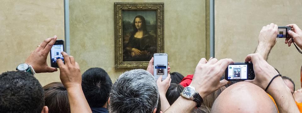 Turistas ante la Gioconda